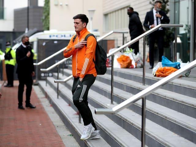 Manchester United captain Harry Maguire leaving the team hotel after the match against Liverpool was called off