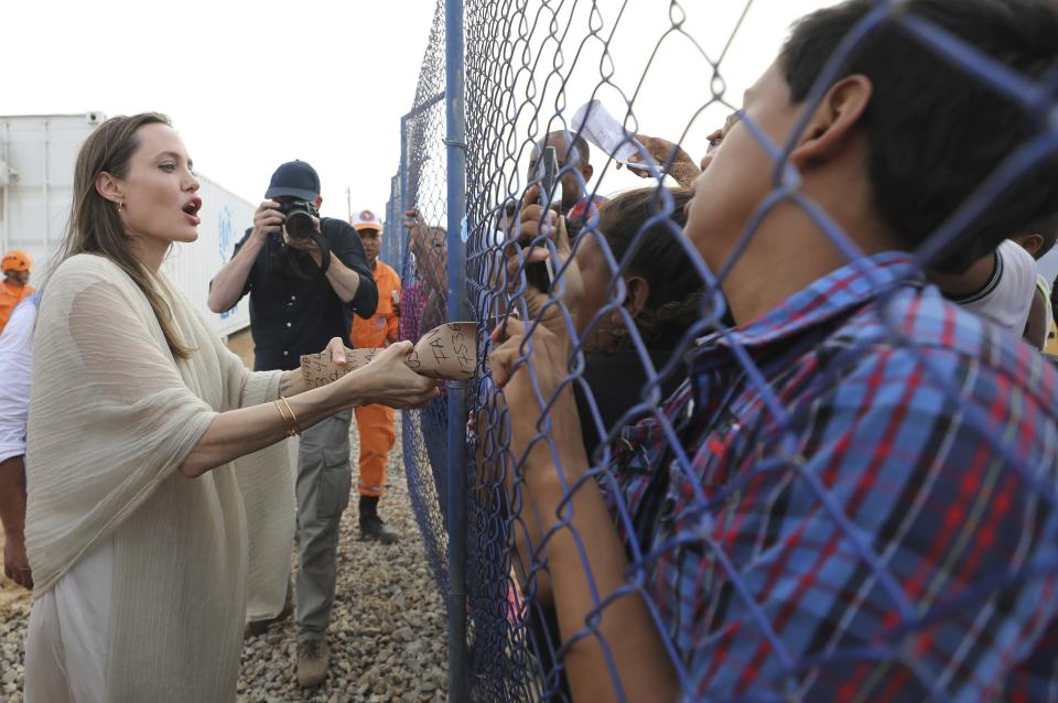 FILE - In this June 8, 2019 file photo, UNHCR's special envoy Angelina Jolie meets with Venezuelan migrants at a United Nations-run camp in Maicao, Colombia, on border with Venezuela. Jolie told the weekly German newspaper, Welt am Sonntag, Sunday, Sept 5, 2021, that she has concern about the situation of women and girls in Afghanistan. The actress said she doesn't think the incoming government in Afghanistan could simply turn back the clock so that everything would be like 20 years ago, but she still has big worries about the situation for women there. (AP Photo/Fernando Vergara, File)