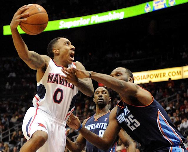 Atlanta Hawks guard Jeff Teague (0) is fouled by Charlotte Bobcats' Al Jefferson (25) in the first half of their NBA basketball game on Saturday, Dec. 28, 2013, in Atlanta. (AP Photo/David Tulis)