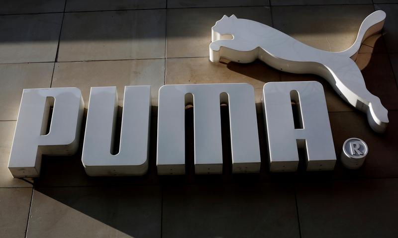 FILE PHOTO:The logo of German sports goods firm Puma is seen at the entrance of one of its stores in Vienna