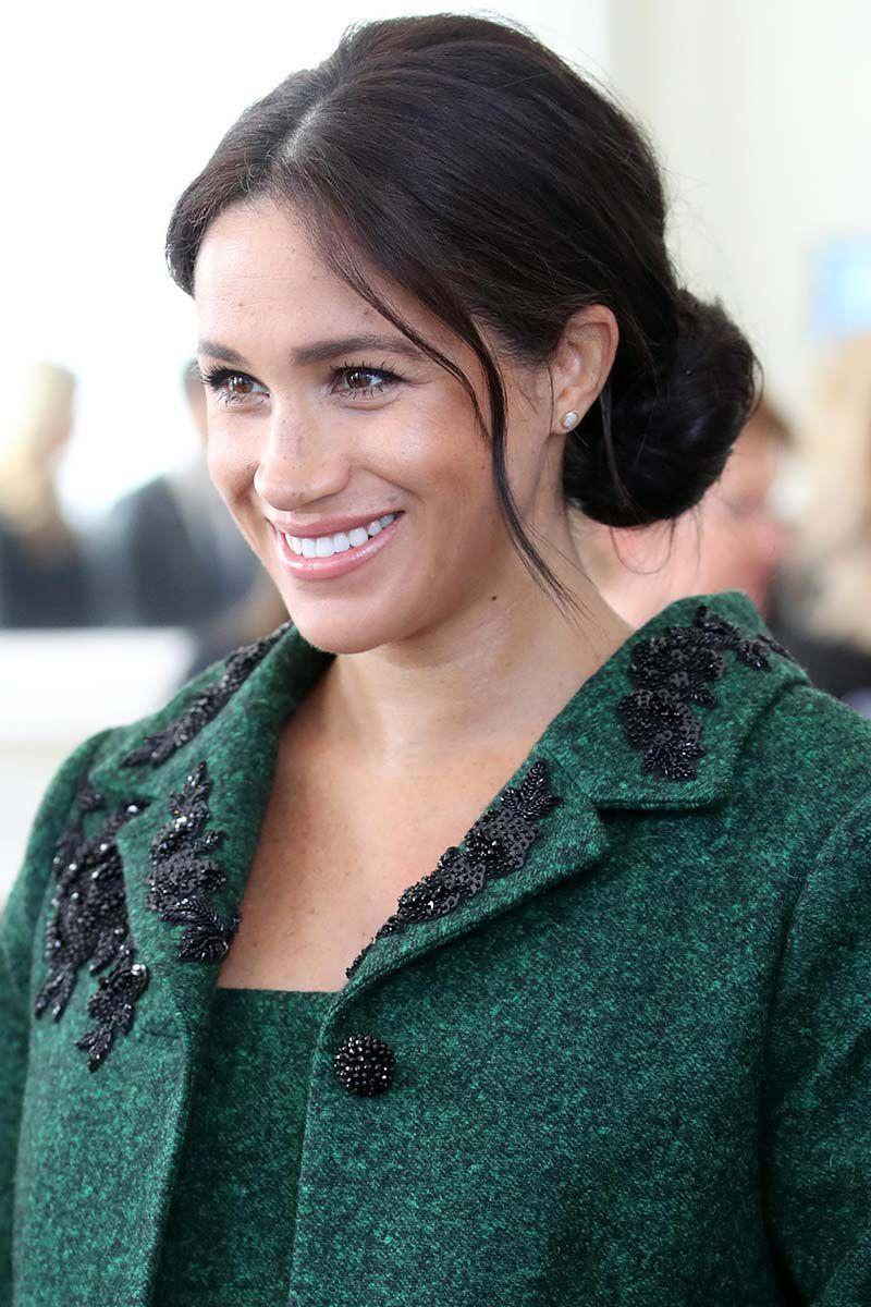 <p>The Duchess of Sussex attended a Commonwealth Day Youth Event wearing a low bun complete with loose tendrils. </p>