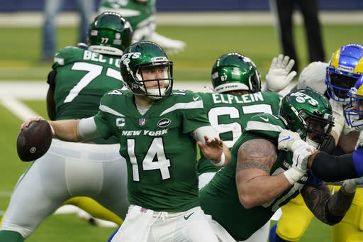 New York Jets quarterback Sam Darnold throws against the Los Angeles Rams during the first half of an NFL football game Sunday, Dec. 20, 2020, in Inglewood, Calif. (AP Photo/Ashley Landis)