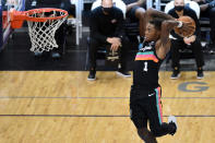 San Antonio Spurs guard Lonnie Walker IV goes up for a dunk in the second half of the team's NBA basketball game against the Memphis Grizzlies on Wednesday, Dec. 23, 2020, in Memphis, Tenn. (AP Photo/Brandon Dill)