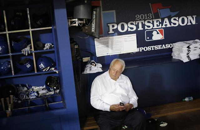 Former Los Angeles Dodgers manager Tommy Lasorda sits in the Dodgers' dugout before Game 1 of the National League Divisional Series against the Atlanta Braves, Thursday, Oct. 3, 2013, in Atlanta. (AP Photo/David Goldman)