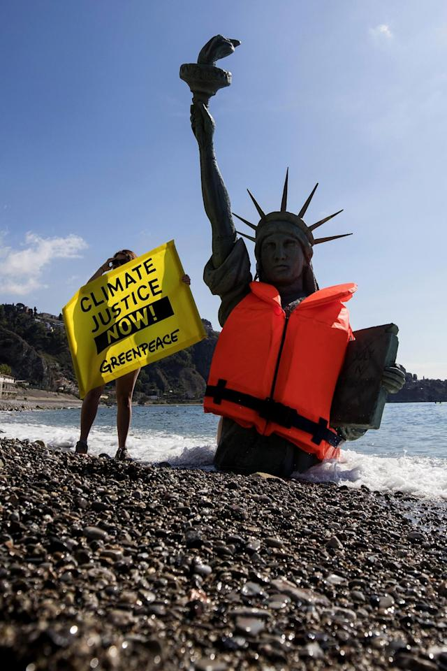 <p>Greenpeace activists stage a demonstration in Giardini Naxos, near the venue of the G7 summit in the Sicilian town of Taormina, southern Italy, Friday, May 26, 2017. Climate change promises to be the most problematic issue for this summit after Trump's decision to review U.S. policies related to the Paris Agreement on fighting global warming. (Angelo Carconi/ANSA via AP) </p>