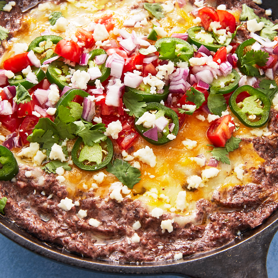 """<p>Blended with lots of garlic, jalapeño, and cheese, then topped with <em>even more cheese </em>before baking, this dip makes a party-pleasing app. If it happens to turn into dinner, we won't complain.</p><p><em><a href=""""https://www.delish.com/cooking/recipe-ideas/a25922105/black-bean-dip-recipe/"""" rel=""""nofollow noopener"""" target=""""_blank"""" data-ylk=""""slk:Get the recipe from Delish »"""" class=""""link rapid-noclick-resp"""">Get the recipe from Delish »</a></em></p>"""