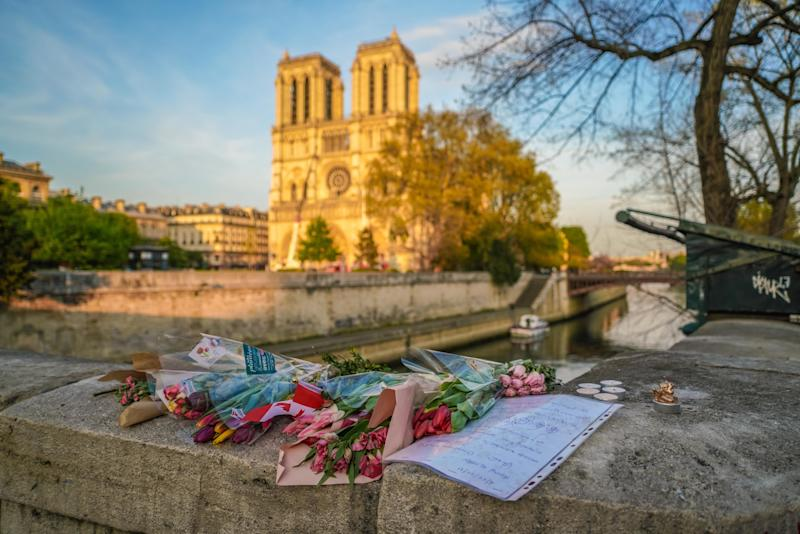 Flowers are placed in front of Notre Dame Cathedral on April 18, 2019 in Paris, France.  (Photo: Edward Berthelot via Getty Images)