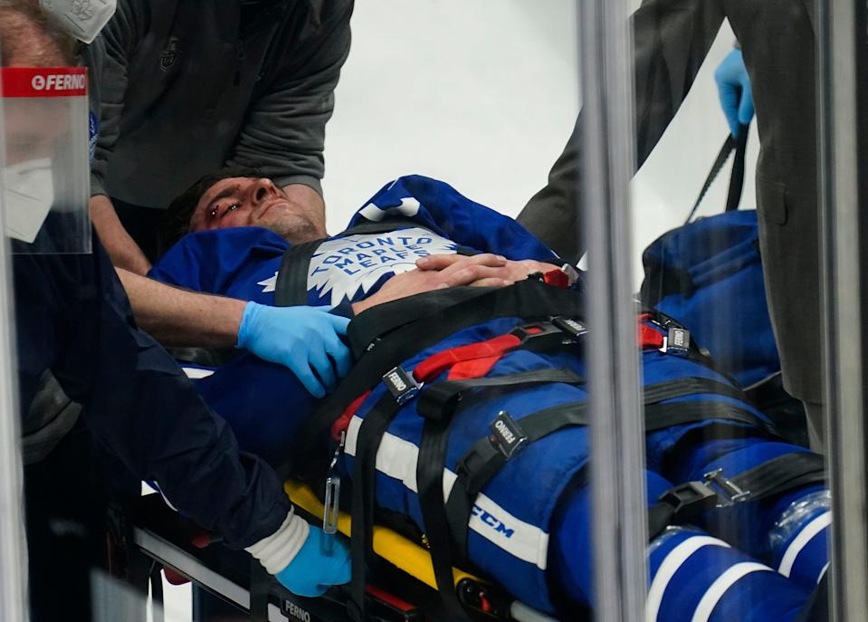 Toronto Maple Leafs forward John Tavares is taken off of the ice on a stretcher after a collision with Montreal Canadiens forward Corey Perry.