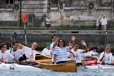 Paris Mayor Anne Hidalgo (R) and the co-president of the Paris bid for the 2024 Olympics Tony Estanguet (L) take a selphie while they sail on the Seine river in Paris, France, June 23, 2017. Paris is transformed into a giant Olympic park to celebrate International Olympic Days with a variety of sporting events for the public across the city during two days as the city bids to host the 2024 Olympic and Paralympic Games.  REUTERS/Martin Bureau/Pool