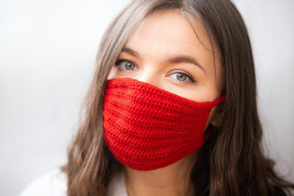 woman wearing red knit mask