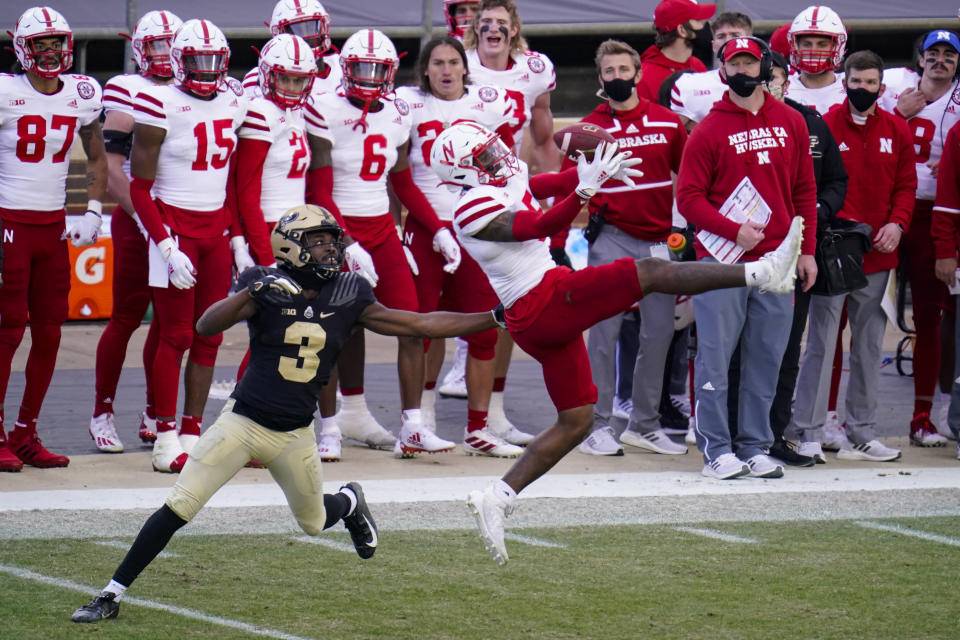 Nebraska cornerback Cam Taylor-Britt (5) breaks up a pass intended for Purdue wide receiver David Bell (3) during the fourth quarter of an NCAA college football game in West Lafayette, Ind., Saturday, Dec. 5, 2020.  (AP Photo/Michael Conroy)