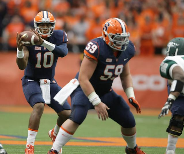 Syracuse's Terrel Hunt (10) takes a snap as Syracuse's Mackey MacPherson (59) looks to block Wagner's Ryan Brenner (98) in the second quarter of an NCAA college football game in Syracuse, N.Y. Saturday, Sept. 14, 2013. Syracuse defeated Wagner 54-0. (AP Photo/Nick Lisi)
