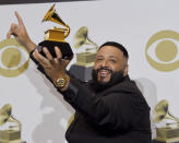 "DJ Khaled poses in the press room with the award for best rap/sung performance for ""Higher"" at the 62nd annual Grammy Awards at the Staples Center on Sunday, Jan. 26, 2020, in Los Angeles. (AP Photo/Chris Pizzello)"