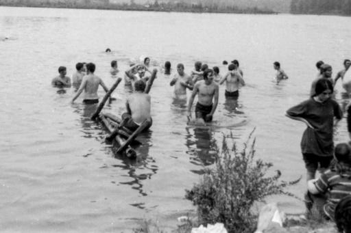 Festival goers take a dip at the 1969 Woodstock music festival, considered by many a pivotal moment for rock music and 1960s counterculture