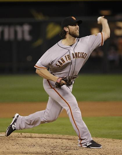 Madison Bumgarner threw five shutout innings in Game 7. (AP)