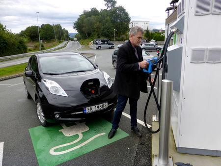 Nordboe recharges his Nissan Leaf electric car in Finnoey