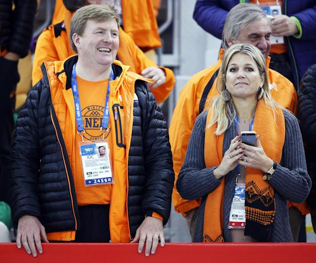 Dutch King Wilem-Alexander, left, and Queen Maxima stand during the flower ceremony for the men's 500-meter speedskating race, where country athletes won the gold, silver and bronze, at the Adler Arena Skating Center at the 2014 Winter Olympics, Monday, Feb. 10, 2014, in Sochi, Russia. (AP Photo/Patrick Semansky)
