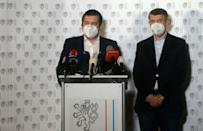 Czech Prime Minister Andrej Babis (R) and Czech Foreign Minister and Interior Minister Jan Hamacek wear face masks at a press conference in Prague where it was announced that the Czech Republic will expel 18 Russian diplomats who were involved in the case of a blast in an munitions depot in Vrbetice in December 2014. The Czech government said it will expel 18 Russian diplomats identified by local intelligence as secret agents of the Russian SVR and GRU services that are suspected of involvement in a 2014 explosion.