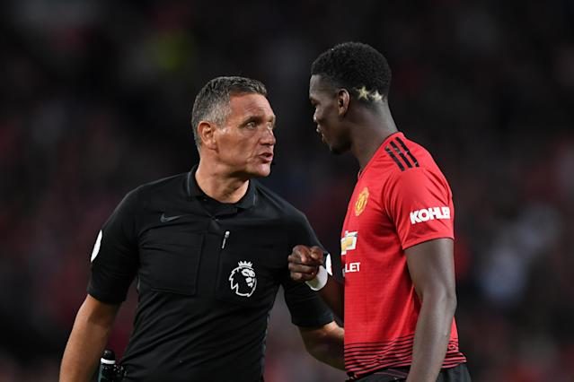 Andre Marriner asks Paul Pogba if there is anything he wants to pass on to Jose Mourinho