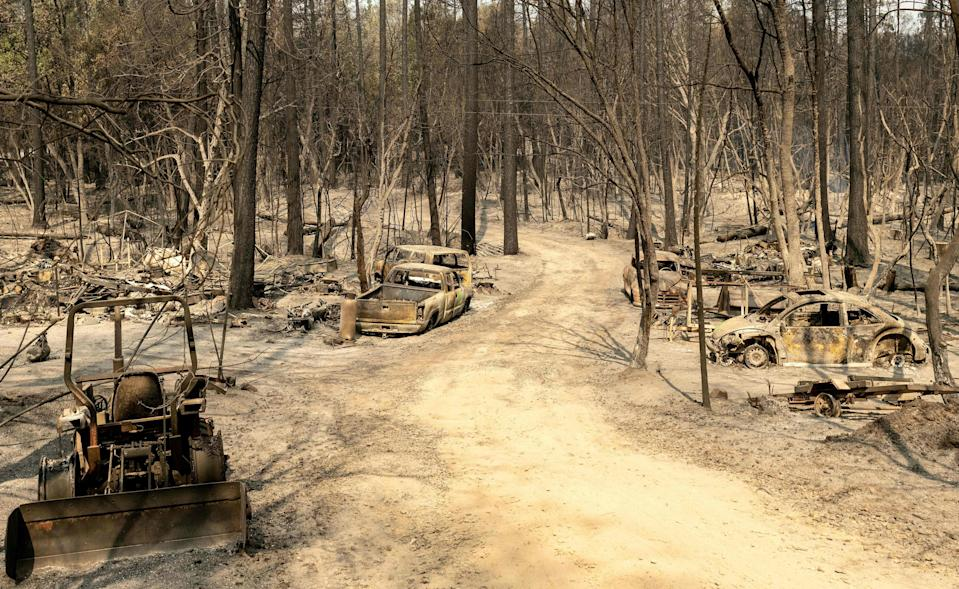 A residential area in the Berry Creek area of northern California smoulders after the Bear Fire tore through the region last September (AFP via Getty Images)