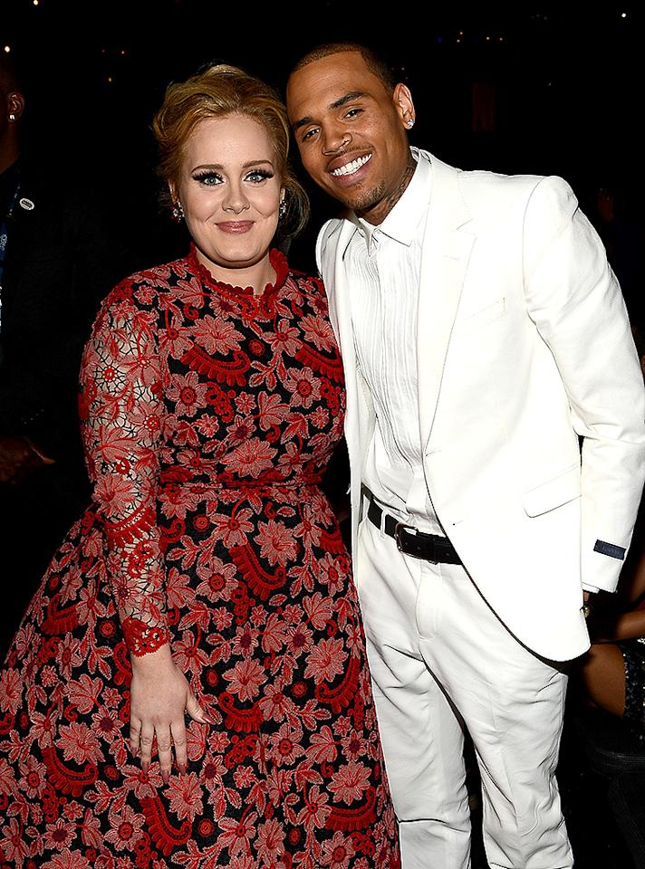 LOS ANGELES, CA - FEBRUARY 10:  Musician Adele (L) and singer Chris Brown attend the 55th Annual GRAMMY Awards at STAPLES Center on February 10, 2013 in Los Angeles, California.  (Photo by Larry Busacca/WireImage)