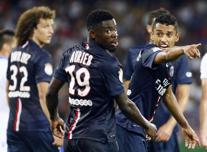 PSG's Marquinhos (R) gestures next to teammate Serge Aurier during a friendly match against SSC Napoli, as part of the 2014 Acqua Lete Cup, at the San Paolo Stadium in Naples, Italy, on August 11, 2014 (AFP Photo/Carlo Hermann)