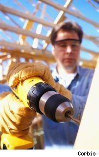 construction worker with power drill