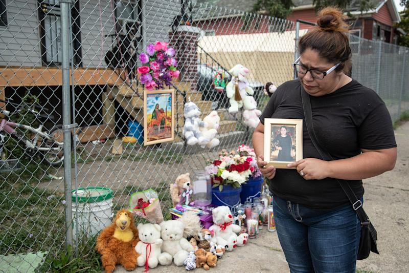 Claudia Stapleton, aunt of Emma Hernandez, 9, holds a photo of her outside of her home in Detroit on Tuesday, Aug. 20, 2019.