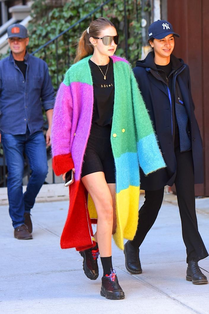 "<h1 class=""title"">Gigi Hadid gets playful in a fuzzy colorblocked trench coat while out in NYC</h1> <div class=""caption""> Backgrid </div> <cite class=""credit"">KEVY, JWNY</cite>"