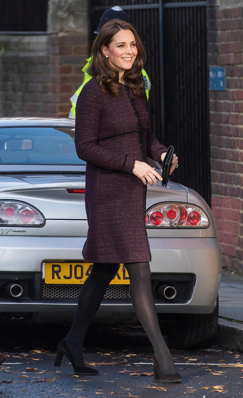 <p>Kate arrived at the Magic Mums Christmas party in North Kensington wearing a burgundy boucle coat by maternity label Seraphine. The Duchess first donned the design back in 2014. <i>[Photo: Getty]</i> </p>