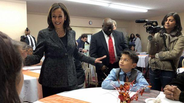 PHOTO: Democratic presidential candidate Sen. Kamala Harris, D-Calif., speaks to Aaron Nachampassak, 11, right and others at a church congregation breakfast in Fort Dodge, Iowa, on Nov. 10, 2019. (Kathleen Ronayne/AP)