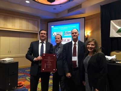 (from left to right) Chris Weikle, senior manager government affairs, Southwestern Energy; James Martin, director, West Virginia Department of Environmental Protection; Brett Loflin, vice president, regulatory affairs, Northeast Natural Energy; and Amy Dobkin, community relations manager, Southwestern Energy, accept an award from the West Virginia Department of Environmental Protection on behalf of Southwestern Energy.