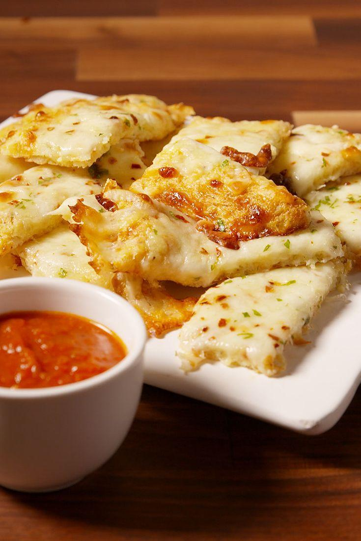 """<p>These low carb snacks are seriously addictive.</p><p>Get the recipe from <a href=""""https://www.delish.com/cooking/recipe-ideas/recipes/a50705/cheesy-cauli-bread-recipe/"""" rel=""""nofollow noopener"""" target=""""_blank"""" data-ylk=""""slk:Delish"""" class=""""link rapid-noclick-resp"""">Delish</a>.</p>"""