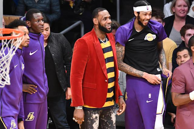 """<a class=""""link rapid-noclick-resp"""" href=""""/nba/players/3704/"""" data-ylk=""""slk:LeBron James"""">LeBron James</a> isn't playing now, but when he is on the court he says he is the greatest of all time. (Getty)"""
