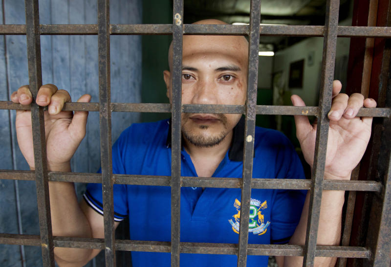 In this May 22, 2012 photo, Nazarrudin Saidin, who was recently released after being kidnapped in the Philippines about a year ago, talks during an interview at his home in Sungai Buloh near Kuala Lumpur, Malaysia. The Malaysian gecko trader held captive by suspected Abu Sayyaf militants for a year says he saw teenagers as young as 15 skilled in using M16 rifles that seemed readily available in impoverished villages in the southern Philippines. (AP Photo/Mark Baker)