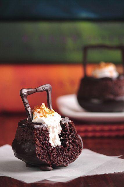 """<p>These bubbling cauldron cupcakes are nothing to be afraid of.</p><p><strong>Get the recipe at </strong><strong><a href=""""http://www.pastryaffair.com/blog/2011/7/12/cauldron-cakes.html"""" rel=""""nofollow noopener"""" target=""""_blank"""" data-ylk=""""slk:Pastry Affair"""" class=""""link rapid-noclick-resp"""">Pastry Affair</a>.</strong></p><p><strong><strong><strong><a class=""""link rapid-noclick-resp"""" href=""""https://www.amazon.com/Wilton-Non-Stick-Muffin-Cupcake-Baking/dp/B00KIFBI1C/?tag=syn-yahoo-20&ascsubtag=%5Bartid%7C10050.g.1366%5Bsrc%7Cyahoo-us"""" rel=""""nofollow noopener"""" target=""""_blank"""" data-ylk=""""slk:SHOP CUPCAKE TINS"""">SHOP CUPCAKE TINS</a></strong></strong></strong></p>"""