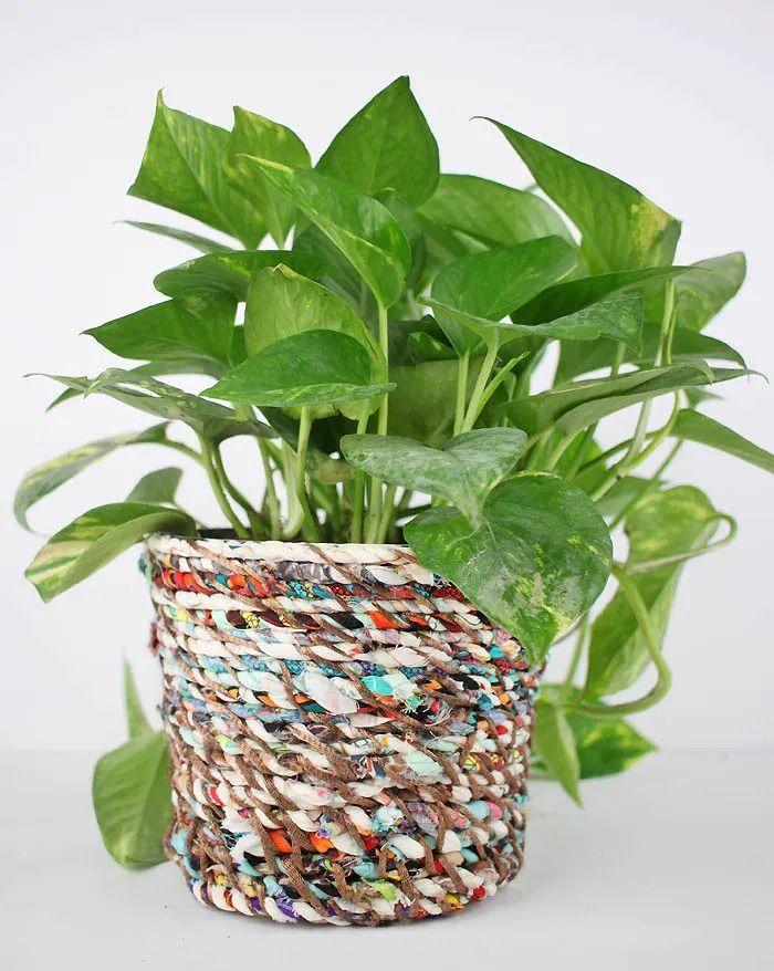 """<p>To give your patio or porch a kaleidoscopic touch, craft this stylish planter using twine made from scrap fabric. </p><p><strong>Get the tutorial at <a href=""""https://gina-michele.com/2017/01/fabric-twine-flower-pot-diy-2.html"""" rel=""""nofollow noopener"""" target=""""_blank"""" data-ylk=""""slk:Gina Michele"""" class=""""link rapid-noclick-resp"""">Gina Michele</a>.</strong></p><p><a class=""""link rapid-noclick-resp"""" href=""""https://go.redirectingat.com?id=74968X1596630&url=https%3A%2F%2Fwww.walmart.com%2Fsearch%2F%3Fquery%3Dsewing%2Bneedles&sref=https%3A%2F%2Fwww.thepioneerwoman.com%2Fhome-lifestyle%2Fgardening%2Fg36556911%2Fdiy-planters%2F"""" rel=""""nofollow noopener"""" target=""""_blank"""" data-ylk=""""slk:SHOP SEWING NEEDLES"""">SHOP SEWING NEEDLES</a></p>"""