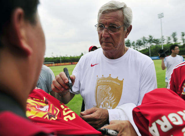 World Cup-winning coach Marcello Lippi signs autographs for his Chinese fans after a training session with his team the Guangzhou Evergrande, in Guangzhou, south China's Guangdong province on June 18, 2012. Guangzhou will take on Saudi Arabia's Al Ittihad in the AFC Champions league two-leg quarterfinals on September 19 and October 2. CHINA OUT AFP PHOTOSTR/AFP/GettyImages