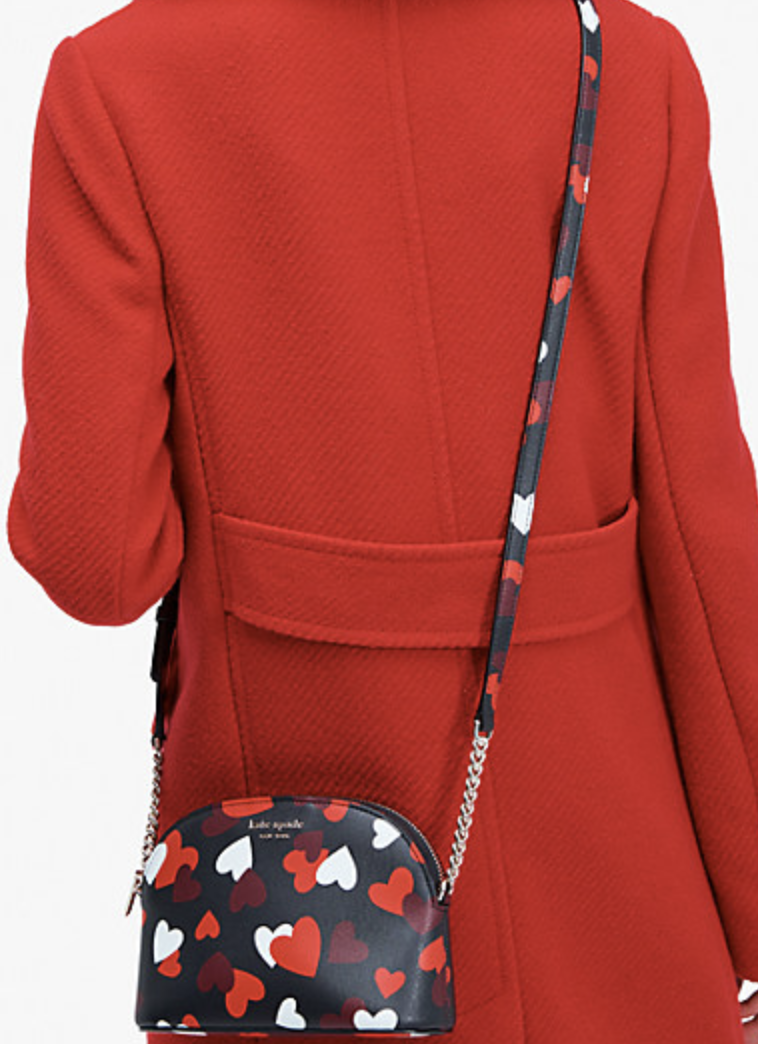 PHOTO: Kate Spade. Spencer celebration hearts small dome crossbody