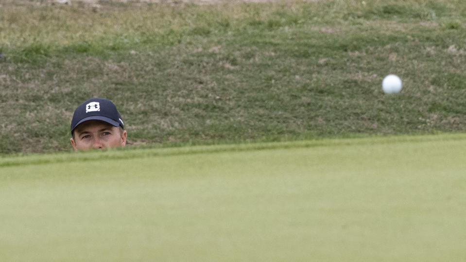 Jordan Spieth watches the ball after hitting from a bunker on the 12th hole during the final round of the Valero Texas Open golf tournament in San Antonio, Saturday, April 4, 2021. (AP Photo/Michael Thomas)
