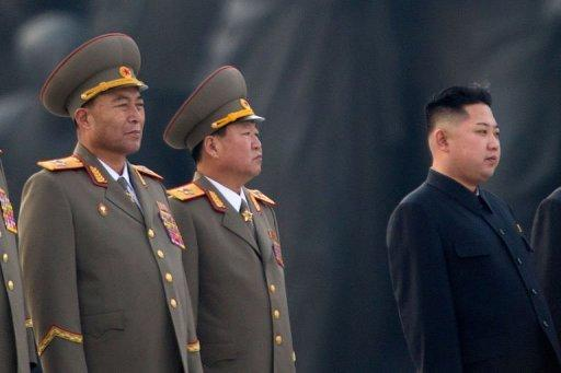 This photo, taken on April 13, shows North Korean military chief Ri Yong-Ho (L) and North Korean leader Kin Jong-Un (R), seen during a ceremony in Pyongyang. Ri has been relieved of all his posts due to illness, state media reported on July 16, in a surprise development that removes one of Kim's inner circle