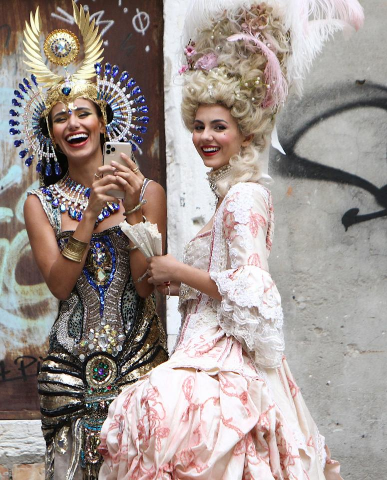 Victoria Justice and Madison Reed have some fun in their Venice Carnival costumes while out in Italy on Friday.