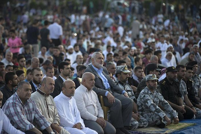 Hamas, whose chief Ismail Haniya is shown attending prayers in Gaza City in June, has agreed to steps toward resolving a decade-long split with Palestinian president Mahmud Abbas's Fatah (AFP Photo/MAHMUD HAMS)