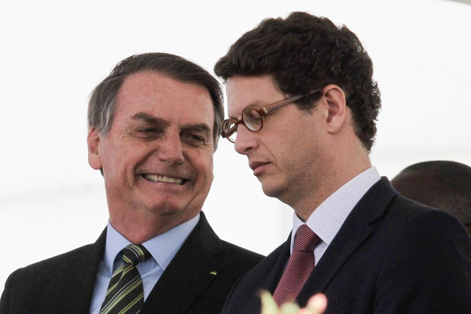 Brazilian President Jair Bolsonaro (L) and his Minister of the Environment Ricardo Salles gesture during a military event in Sao Paulo, Brazil on October 11, 2019.  (Photo by Fabio Vieira/FotoRua/NurPhoto via Getty Images)