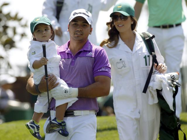 Australian golfer Jason Day is joined by his son Dash (L) and his wife Ellie (R) on the first hole of the Par 3 contest ahead of the Masters golf tournament at the Augusta National Golf Club in Augusta, Georgia April 9, 2014. REUTERS/Mike Segar (UNITED STATES - Tags: SPORT GOLF)