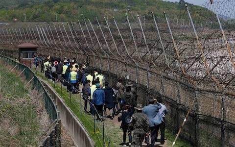 The border with South Korea remains highly militarised despite recent peace talks - Credit: JEON HEON