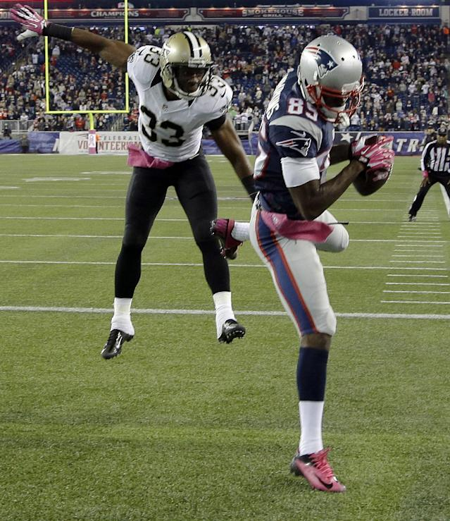 New England Patriots wide receiver Kenbrell Thompkins (85) comes down in the end zone with the winning touchdown catch against New Orleans Saints cornerback Jabari Greer (33) in the fourth quarter of an NFL football game Sunday, Oct.13, 2013, in Foxborough, Mass. The Patriots won 30-27. (AP Photo/Stephan Savoia)