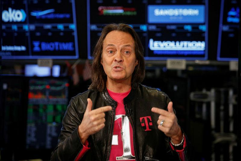 T-Mobile CEO John Legere speaks about his company's merger with Sprint during an interview on CNBC on the floor of the NYSE in New York City