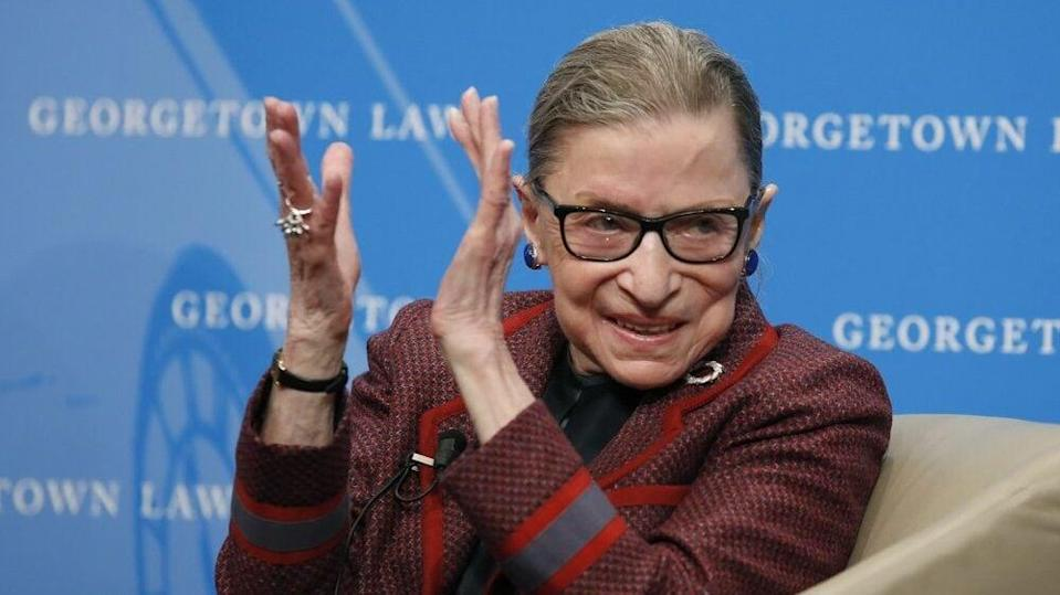 In this April 6, 2018, file photo, Supreme Court Justice Ruth Bader Ginsburg applauds after a performance in her honor after she spoke about her life and work during a discussion at Georgetown Law School in Washington. (AP Photo/Alex Brandon, File)