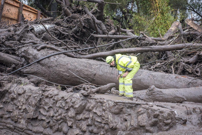 <p>Cesar Limon of the Montecito Water Dristrict surveys the area of Montecito Creek where flash flooding destroyed homes in Montecito, Calif., on Jan.9, 2018. (Photo: Erick Madrid via ZUMA Wire) </p>